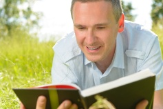 Man enjoying reading outside