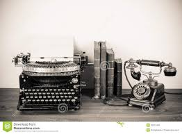 typewriter, telephone, and books